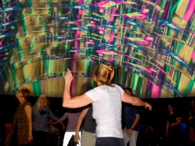 "Disco with dancing people with live VJing visuals in our mobile 360degree event location ""infinityDome""."